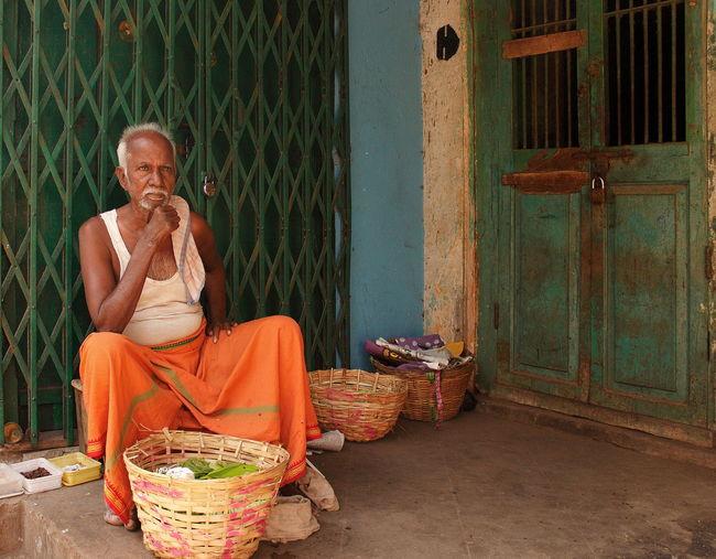 Man sitting on wicker basket