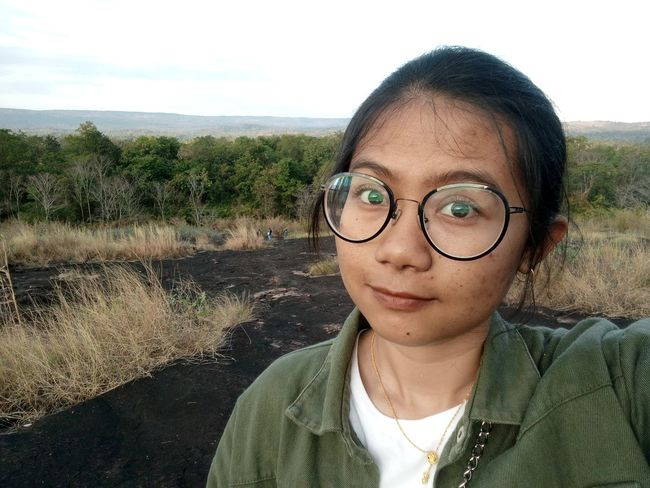 traveler girl One Woman Only Outdoors Outdoor Girl One Person Alone EyeEm Selects Portrait Eyeglasses  Looking At Camera Human Eye Human Face Headshot Close-up Sky