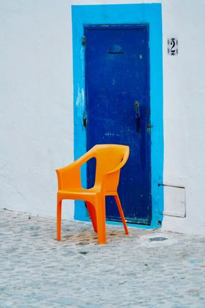 Ibiza travel Ibiza, Spain Blue Door Into The Unknown Orange Chair EyeEm Selects Blue Door Chair No People Architecture Built Structure Outdoors Day
