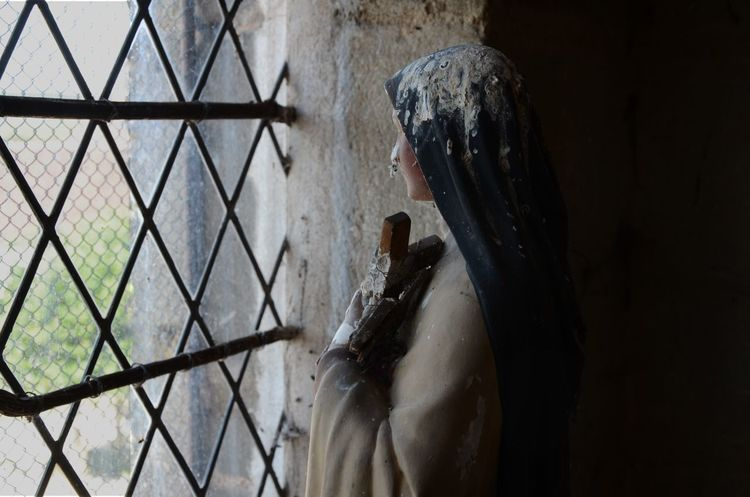 Church Memories Virgin Mary Abandoned Day Dropping Droppings Human Representation Indoors  Lifestyles Locked Up Maiden Marie Old One Person People Praying Real People Sadness Sculpture Statue Trapped Window Women