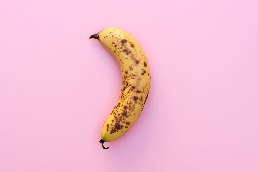 Smoothie banana on pink background Banana Close-up Colored Background Copy Space Directly Above Food Food And Drink Freshness Fruit Healthy Eating Indoors  No People Pink Background Pink Color Ripe Single Object Snack Still Life Studio Shot Tropical Fruit Wellbeing Yellow