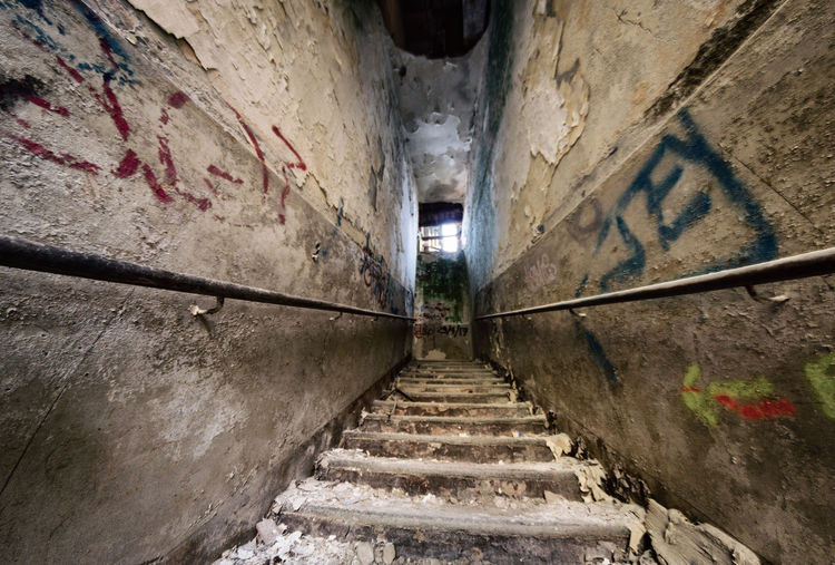 Mental Hospital  Architecture Staircase Steps And Staircases Built Structure Wall - Building Feature Direction Building The Way Forward Railing No People Building Exterior Narrow Day Old Outdoors Wall Graffiti Abandoned Weathered Alley