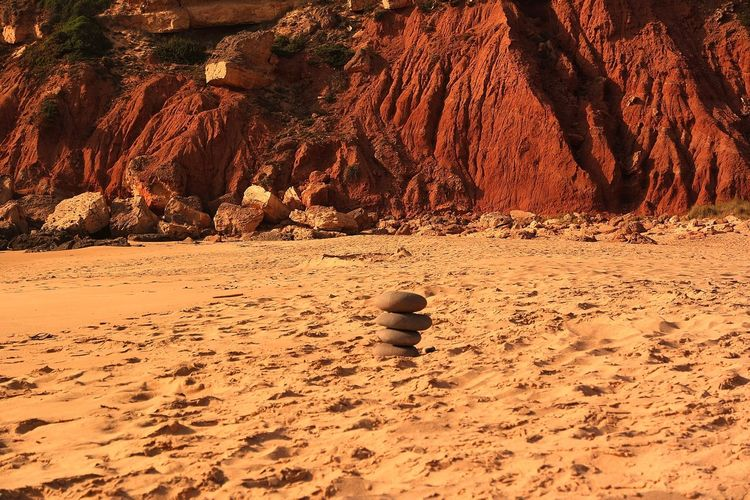 Stones in the sand - beautiful colors of nature Backgrounds Full Frame Travel Vanlife Vanlifediaries Love Portugal Happy Moments Magic Moments Sunlight Ocean Outdoors Lonely Beach Beauty In Nature Redmountains Redsand Stones Stones And Sand Beachlife Sand Dune Beach Desert Sand Arid Climate FootPrint Track - Imprint Close-up Rock Formation Arid Landscape Shore Sandy Beach The Great Outdoors - 2018 EyeEm Awards The Traveler - 2018 EyeEm Awards EyeEmNewHere Creative Space The Photojournalist - 2018 EyeEm Awards Summer Road Tripping My Best Travel Photo 50 Ways Of Seeing: Gratitude A New Perspective On Life Holiday Moments 17.62° My Best Photo