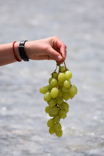 Woman Food Fresh Fruit Grapes Hand Outdoors River Water Green
