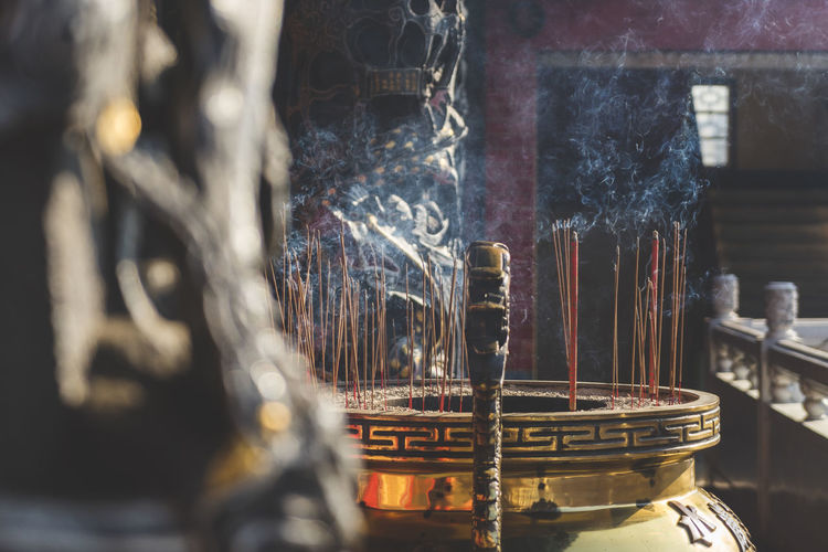 Incense Sticks Burning In Container At Temple