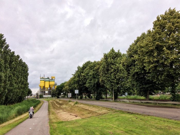 The Netherlands Industrial Architecture Industrial Area Factory Building Factory Man Made Object Cilinder Yellow Industrialbeauty Industrial Landscapes Silo Industrial And Nature Nature Field Trees And Sky Trees Industrial Nature