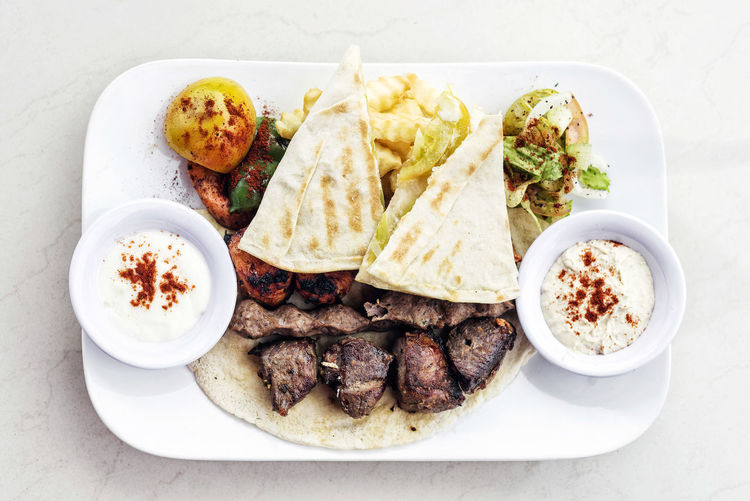 middle eastern grilled meat traditional meal Lebanese Food Meal Bbq Meat Food Garnished Gourmet Grill Grilled Meats High Angle View Meat Middle Eastern Food Plate Set Meal Traditional White Background