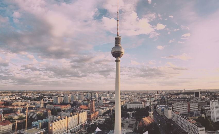 Urban skyline against cloudy sky