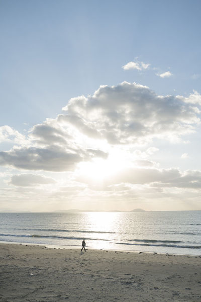 Alone Alone Time Beach Life Beach Photography Japan Lonely Magical One Person Only Sun Rays Through The Clouds Sunlight Sunset_collection Beach Clouds Ocean One Man Only One Person Religious  Small Person Strideby Sun Sun Beams Sun Rays Sunbeams Through Clouds Sunset Walking
