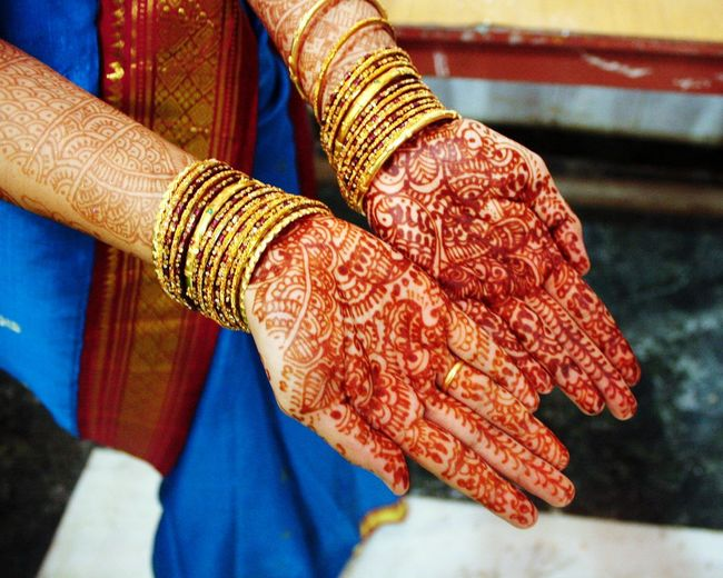Cultures Bangle Adults Only Close-up Life Events Indoors  Wedding Ceremony Bride One Woman Only Adult Wedding People Traditional Clothing Sari Only Women Human Hand One PersonDay Human Body Part Indian Wedding India