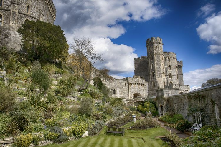 Low Angle View Of Windsor Castle Against Cloudy Sky