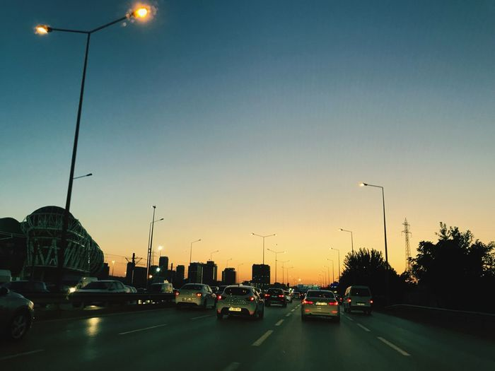 Car Land Vehicle Street Light Transportation Road Traffic Sunset Mode Of Transport City Street Illuminated Built Structure Sky Architecture Building Exterior Outdoors Clear Sky No People Cars