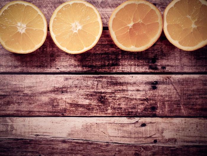 Citrus Fruit Wood - Material Fruit Food And Drink SLICE Healthy Eating Orange - Fruit Orange Color Indoors  Wellbeing Lemon Table Orange Freshness Food Cross Section No People Group Of Objects Still Life Close-up Sour Taste