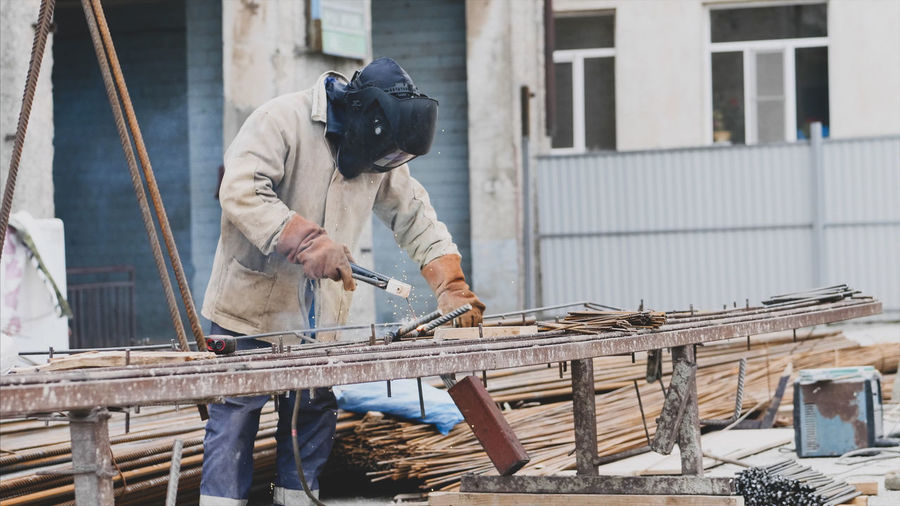 Welder welding at construction site