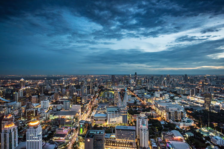 View of Bangkok, Thailand, from above, after sunset Bangkok Thailand. City Dusk Sunset Metropolis Copy Space Horizon Panorama From Above  View Busy Travel Asian  ASIA Thailand Capital Cities  EyeEm Best Shots Landscape No People Wide View Building Exterior Architecture Cityscape Cloud - Sky Sky Built Structure Building Illuminated High Angle View Crowd Nature Crowded City Life Skyscraper Travel Destinations Office Building Exterior Residential District Modern Outdoors Financial District