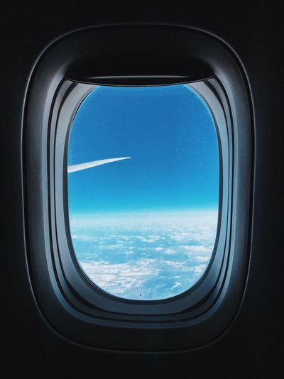 View of airplane wing seen through window