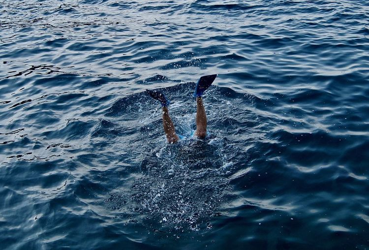 Low section of man snorkeling in sea