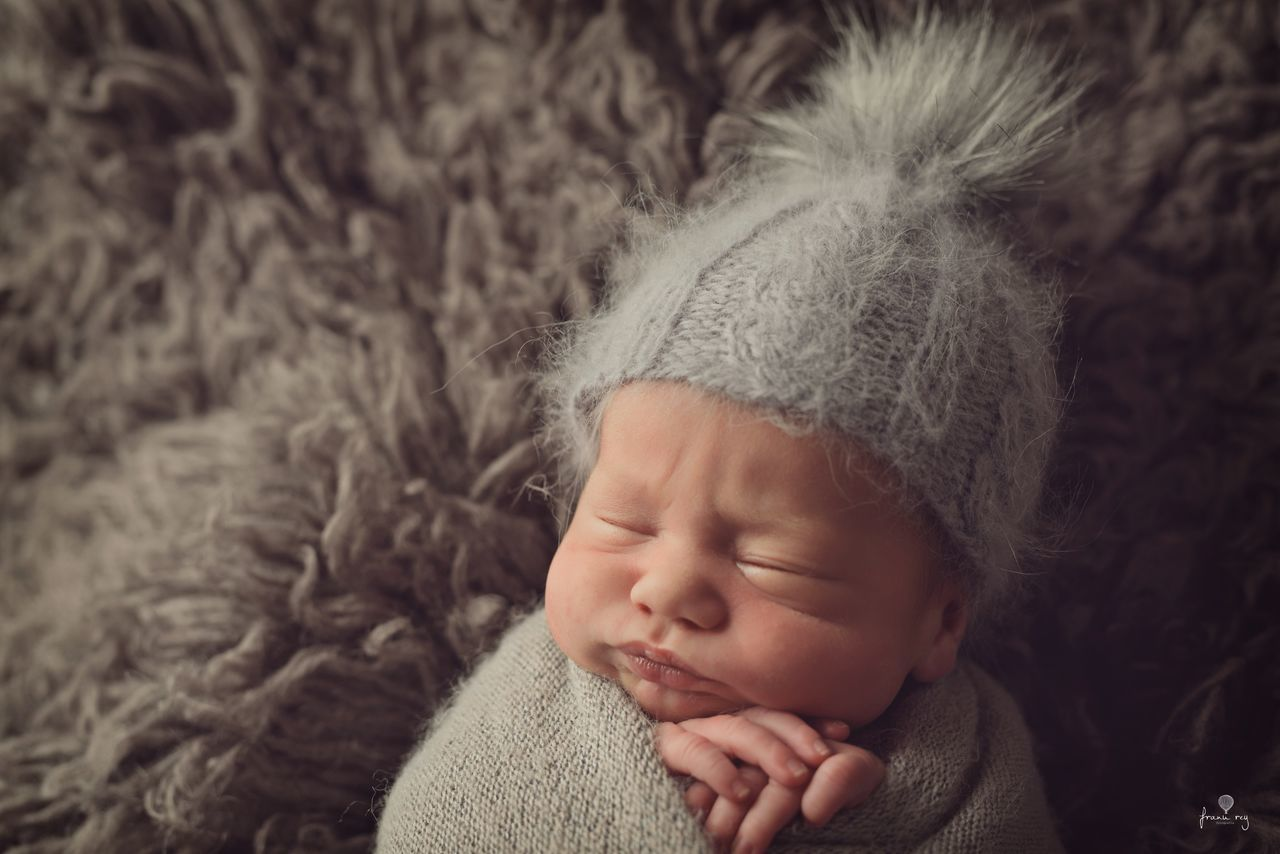childhood, child, one person, innocence, cute, baby, real people, young, indoors, eyes closed, babyhood, sleeping, close-up, headshot, fur, portrait, toddler, blanket, relaxation, warm clothing, wrapped in a blanket, softness
