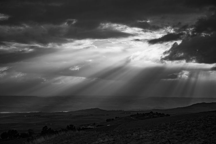 Sun Rays Through The Clouds Beauty In Nature Cloud - Sky Idyllic Landscape Magic Moments Mountains Mountains And Sky Nature Outdoors Sky Sun Rays Tranquil Scene Tranquility Weather Lost In The Landscape Lost In The Landscape Perspectives On Nature Black And White Friday Black And White Friday An Eye For Travel The Great Outdoors - 2018 EyeEm Awards