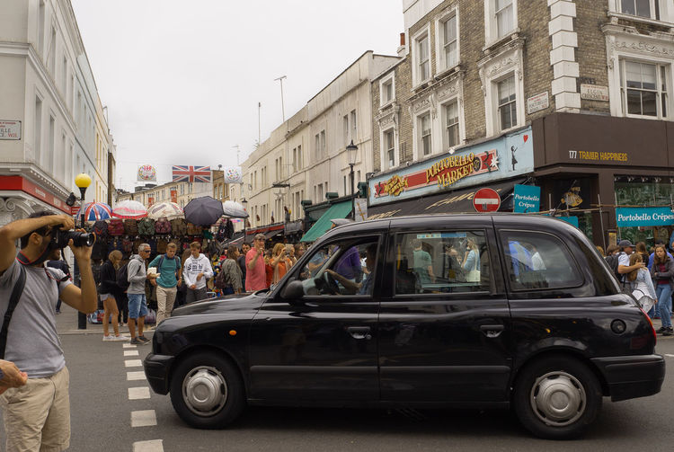 Black Cab on Portobello Architecture Busy City London Market Portobello Market Road Shopping Taxi Tourist Traffic United Kingdom Adult Architecture Building Exterior Built Structure Car City Crowd Day England Europe Group Of People Hustle And Bustle Land Vehicle Large Group Of People Men Mode Of Transportation Modeoftransport Monochrome Motor Vehicle Outdoors Real People Road Street Transportation Urban Vehicle Women
