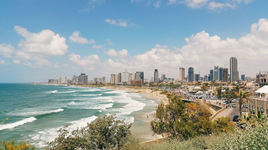 Skyscraper Cloud - Sky Sky Sea Beach Cityscape City Sand Architecture Outdoors Urban Skyline No People Day Building Exterior Nature Israel Telaviv Skyline Sun Middleeast Holyland Summer Startupnation High-rise Buildings