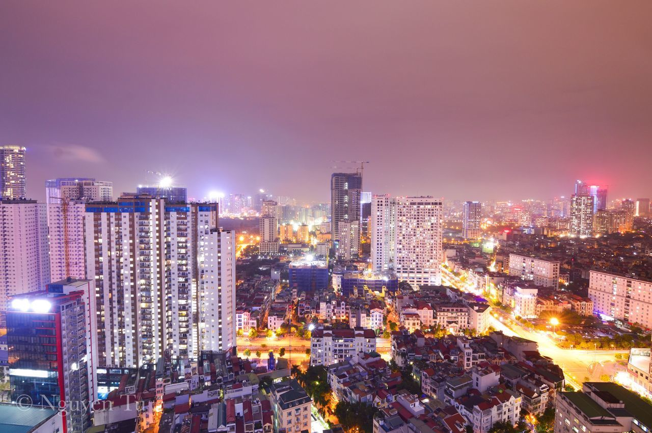 building exterior, city, architecture, built structure, cityscape, illuminated, night, building, office building exterior, skyscraper, crowd, sky, residential district, crowded, modern, city life, tall - high, nature, tower, outdoors, financial district