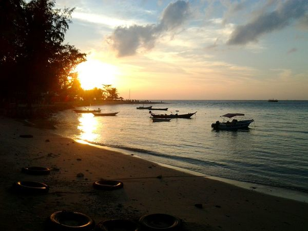 Sunset And Clouds  Sunset Yellowsunset Thailand Tranquility Boats Ocean Island Beach Tyres Palm Trees Paradise Serenity Holiday Relaxing