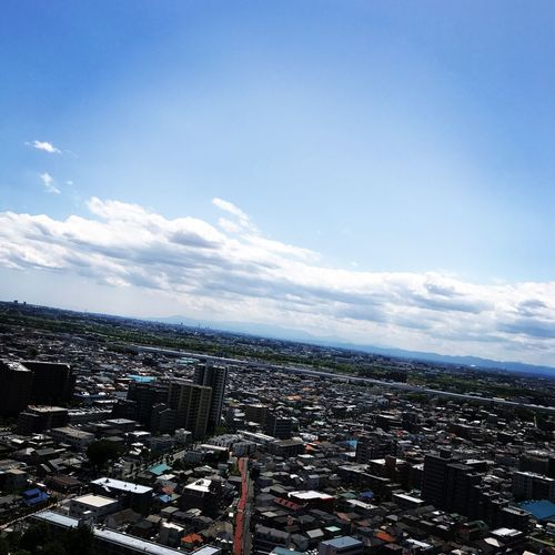 High angle view of city buildings against sky