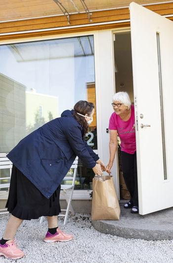 Woman standing in front of door