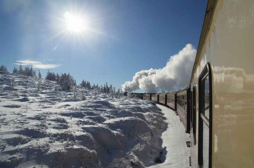 life is just a slow train crawling up a hill Beauty In Nature Brocken Brockenbahn Cold Temperature Day Harz Harzmountains Landscape Lens Flare Mountain Nature No People Outdoors Railway Scenics Sky Snow Snowdrift Steam Train Sun Sunlight Tranquil Scene Tranquility White Color Winter