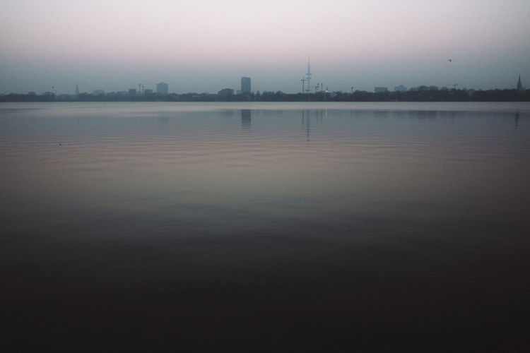 Beauty In Nature Calm City Cityscape Idyllic Nature No People Outdoors Rippled Scenics Sky Sunset Tranquil Scene Tranquility Water Water Surface Waterfront Original Experiences
