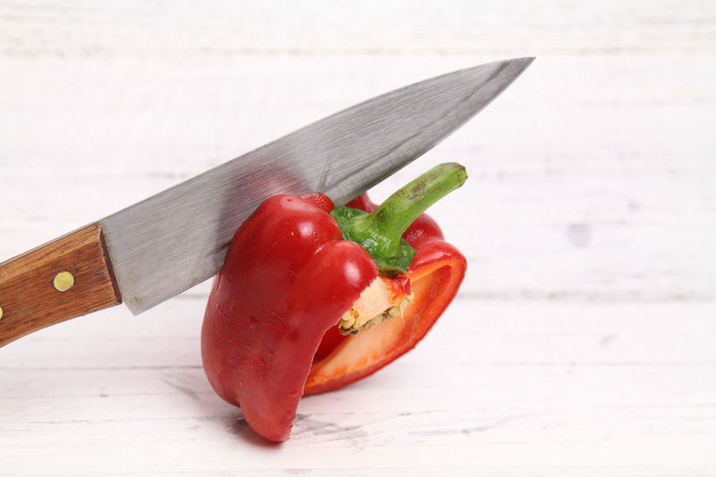 Capsicum Annum being slice with knife over wooden background. Food Preparation Capsicum Annuum Food And Drink Knife Red SLICE Wood Wooden Table Capsicum Capsicum Chinense Capsicum Pepper Chili  Close-up Day Food Food And Drink Food Prep Food Preparation Indoors  Knifeporn No People Slices