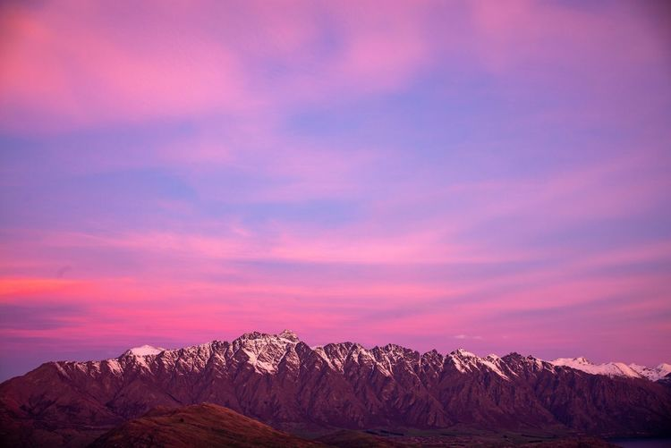 Snowcapped mountains against sky during sunset