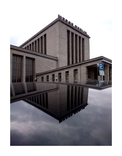 Reflection Built Structure Architecture Building Exterior Sky Symmetry Outdoors No People Berlin Architecture Mirror Metal Urban Landscape Urban Geometry Reflection Streetphotography Walking Around City Just Taking Pictures Travel Photography Taking Photos Traveling Messe Building Battle Of The Cities Discover Berlin