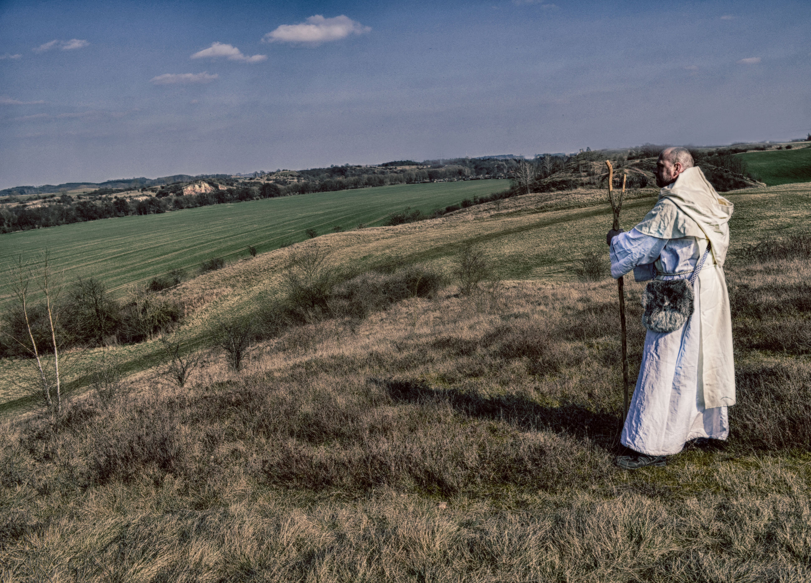 sky, field, land, environment, landscape, grass, one person, plant, nature, real people, full length, adult, scenics - nature, women, clothing, tranquility, beauty in nature, day, non-urban scene, outdoors