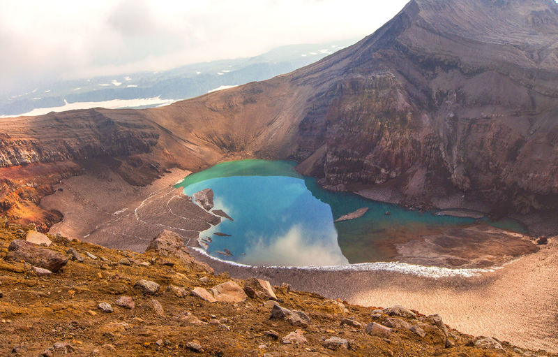 Green lake in the mouth of gorely volcano in kamchatka