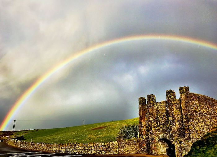 Somewhere over the rainbow Rainbow Double Rainbow Nature No People Day Built Structure Arch Architecture Weather Sky Cloud - Sky Outdoors Beauty In Nature Scenics Grass Building Exterior