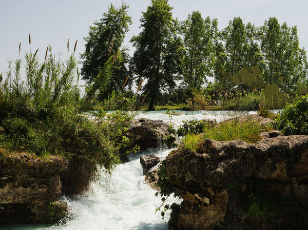 Tarsus Waterfall Beauty In Nature Boulders Flowing Water Greenery Gushing Water Nature River Rock - Object Rushing Water Scenics Shrubs Sky Tarsus Tarsus Şelalesi Tarsus, Turkey, Waterfall, South, Tranquil Scene Tranquility Travel Destinations Trees Turkey Water Waterfall White Water