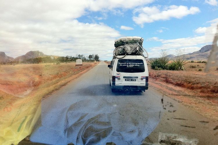 Road on desert against sky