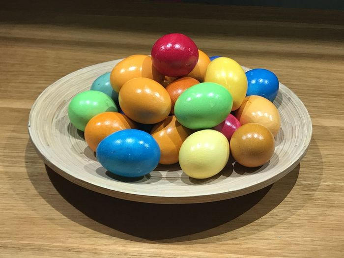 High angle view of multi colored balls in bowl on table