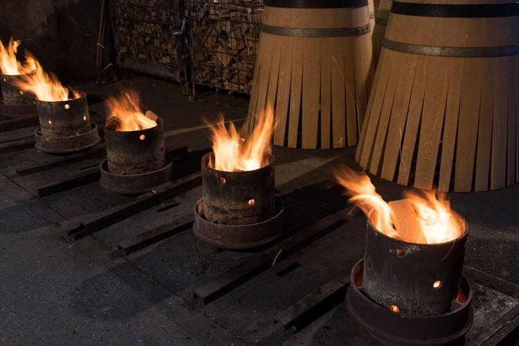 Fire burning amidst barrels