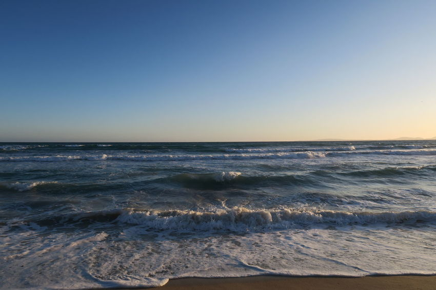 Beach Beauty In Nature Blue Clear Sky Day Horizon Horizon Over Water Motion Nature No People Outdoors Scenics Sea Sky Sunset Surf Tide Tranquil Scene Tranquility Water Wave