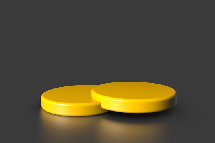 Close-up of yellow candle on table