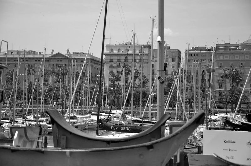 Boats moored against buildings in city