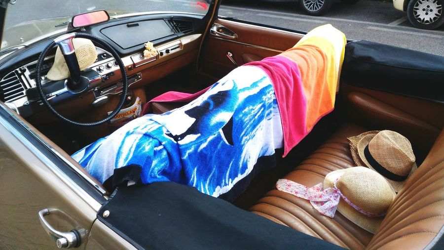 High Angle View Of Hats And Towel In Convertible