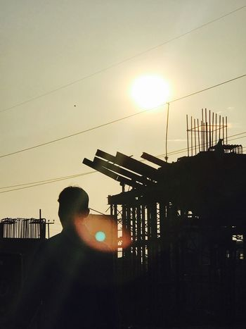 Utkarsh Agarwal Sunset Real People Sun Men Silhouette One Person Built Structure Sunlight Architecture Building Exterior Outdoors Lifestyles Sky City Clear Sky Electricity Pylon One Man Only Day People Paint The Town Yellow