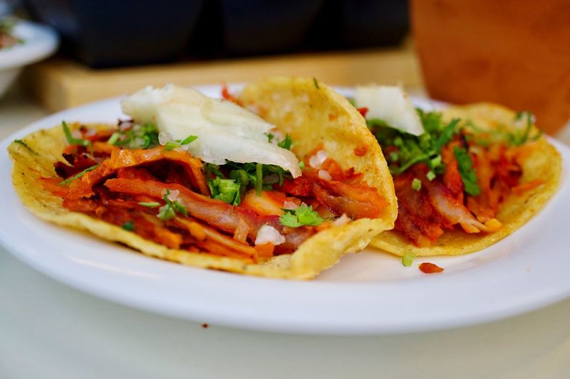 Close-up of tacos in plate on table