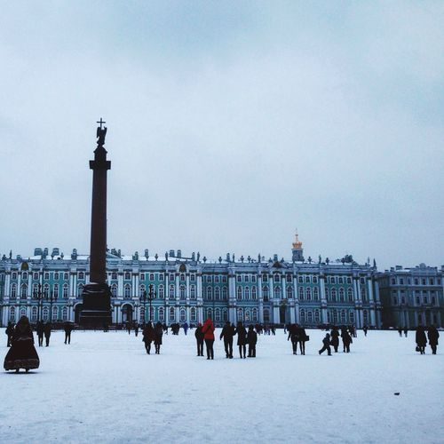 Saint Petersburg Peter Petersburg Winter Cold Temperature Real People Architecture Snow City Built Structure Building Exterior Outdoors Sky Square Large Group Of People Nature Russia EyeEm Gallery EyeEm Beauty In Nature Eyeemphotography (null)White Color Palace Square Alexander Column
