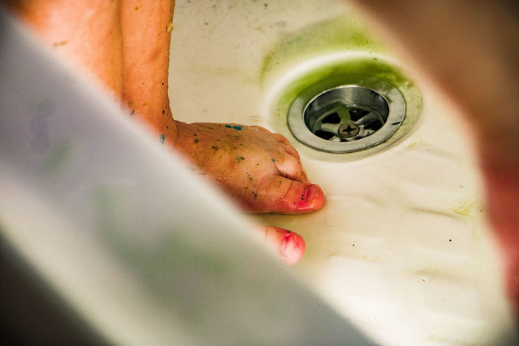 Close-up of dirty feet in bathroom