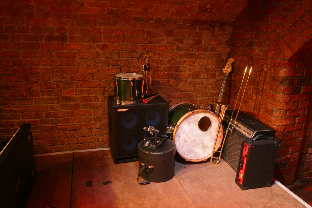 Abandoned Musical Instruments Against Brick Wall